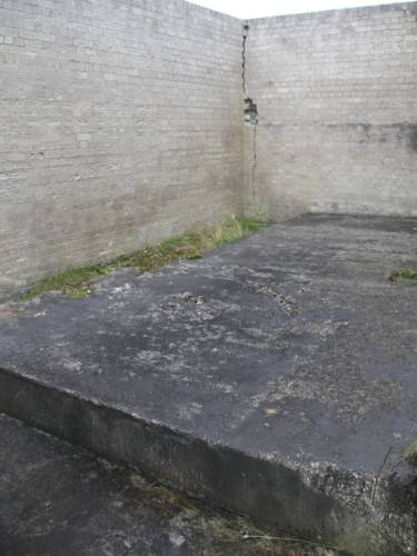 Concrete plinth in yard of main power supply building ND 2044 7658