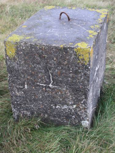 Guy rope concrete block by unknown purpose building ND 2048 7659