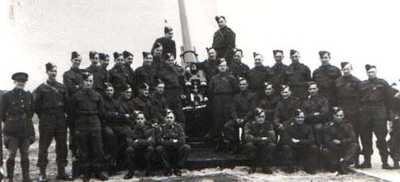 1 - Taken in April 1940 when in 284 HAA Battery RA, TA and shows the entire troop alongside the 3inch gun at Littlehampton, I am standing on left of Barrel.